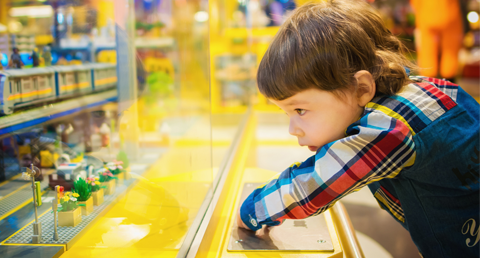 Reboot 2020 child looking in toy shop
